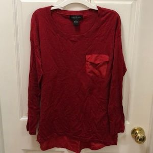 Red scoop neck sweater.